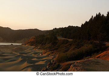 The road along the sandy beach of the Pacific Coast