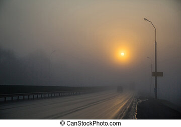 The road in the fog, the sunrise