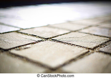 The road is lined with natural stone brown .Texture. Background.