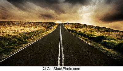 Long straight road at sunset