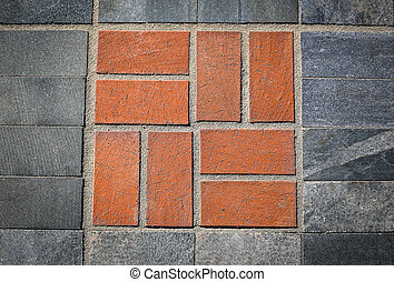 The road is paved with paving stone tiles .Texture. Background.