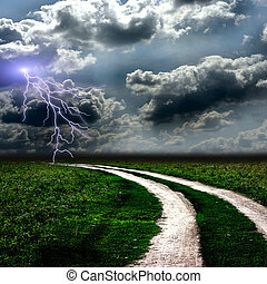The road through  meadow and the stormy sky