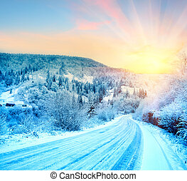 The road to the sunrise in the winter mountains