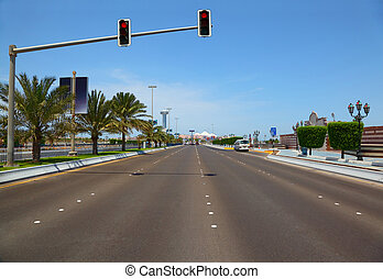 The road with hanging traffic lights to the Marina mall in Abu Dhabi, UAE.