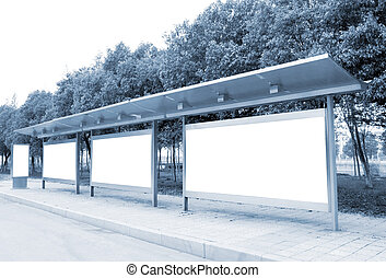 The roadside billboards, bus station.