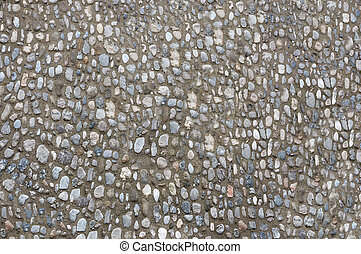 The roadway is lined with small stones