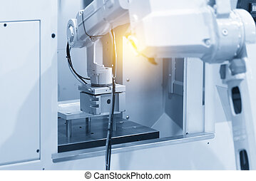 The  robot in modern CNC machine operation.