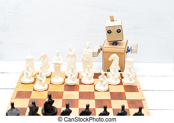 The robot plays a game of chess. Artificial Intelligence