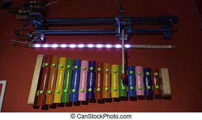 The robot plays music on xylophone - The robot plays music, ...