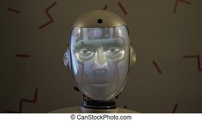 The robot's head speaks and changes the illumination of the face