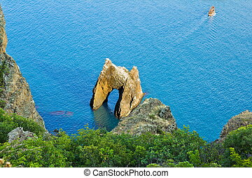 The rock arch in the sea