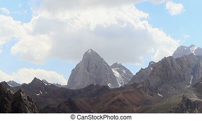 The rock beneath the clouds. Time Lapse, Pamir