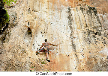 The rock-climber during rock conquest on the big wall