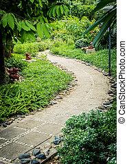 The rock pathway design flowery in garden