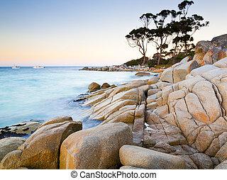 The rocky end of the beach at Binalong Bay Tasmania ...