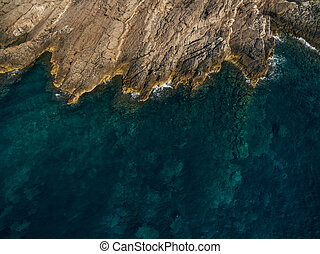 The rocky shore of the Adriatic Sea in Montenegro, aerial top view.