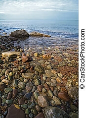 Lake Ontario - The rocky shoreline along Chimney Bluffs ...