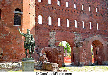 The Roman walls and the statue of Julius Caesar in Turin - Piedmont - Italy