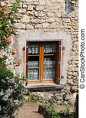 The romantic window with red roses
