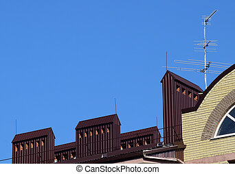 The roof of a multistory building. The roof of the metal...