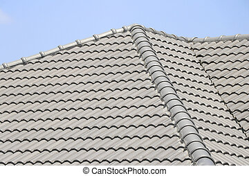 The roof tile with the sky background. The grey roman tile pattern.