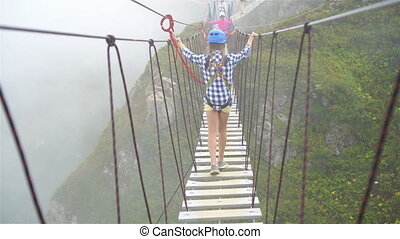 The rope bridge on the top of mountain of Rosa Khutor,...
