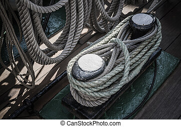 The ropes braided in bays on an ancient sailing vessel