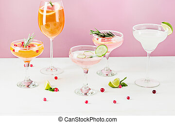 The rose exotic cocktails and fruits on pink