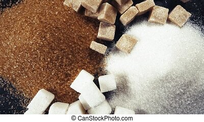 The rotation of the sugar cubes and crystal sugar top view -...