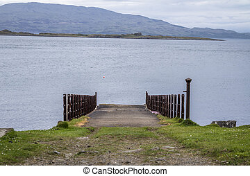 The rotten pier at Craignish point with the Sound of Jura in the background, Scotland
