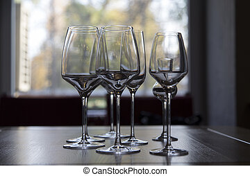 The row of wine glasses on a sill.