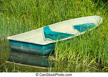 the rowing boat is attached in canes - the plastic boat is...