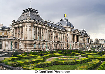 The Royal Palace in Brussels, Belgium from the northeastern corner in spring. National flag of the Kingdom of Belgium waving on top.