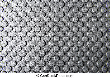 The rubber mats,the rubber mats with the round pattern texture for anti slip.The round pattern texture on the rubber mats.Close-up of rubber mats texture with round pattern in black and white scene.