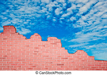 The Ruin of brickwall on blue sky background