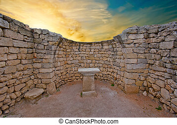 The ruins of an ancient altar in the Greek temple on sunset