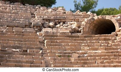 The ruins of an ancient theater in the city of Kas, Turkey. Antique Theater Antiphellos in Kas, Antalya.