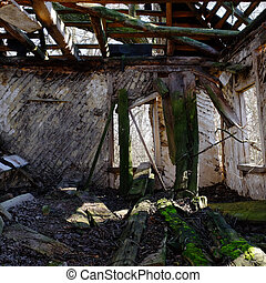 The ruins of an old abandoned house. Inside view. A dilapidated rural house.