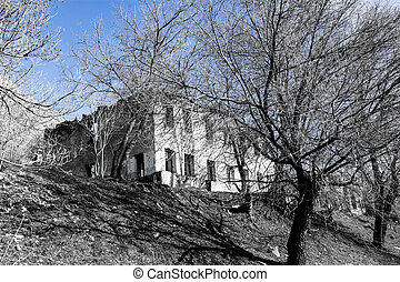 The ruins of an old house against the blue sky