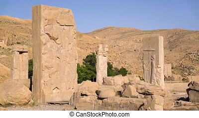 The ruins of the city of persepolis - A shot of the ruined...