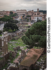 The ruins with the Colosseum of Rome from the monument Vittorio Emanuele II
