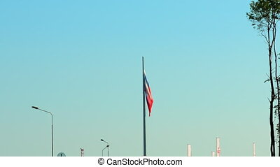 The Russian flag flutters in the wind.