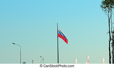 The Russian flag flutters in the wind