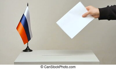 Ballot box with national flag of Russia. Presidential election in 2018. the voter throws the ballot in the ballot box. The camera is fixed
