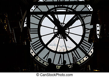 The Sacre Coeur seen through a window of museum D'Orsay, in...