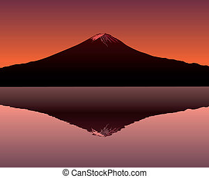 the sacred mountain of Fuji in the background of a red sunset