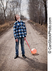 The sad boy with a balloon