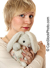 The sad girl the blonde with a toy hare