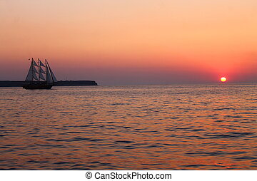 The sailing vessel and the sunset