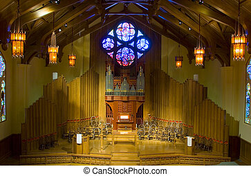 The interior of an American church with a pipe organ